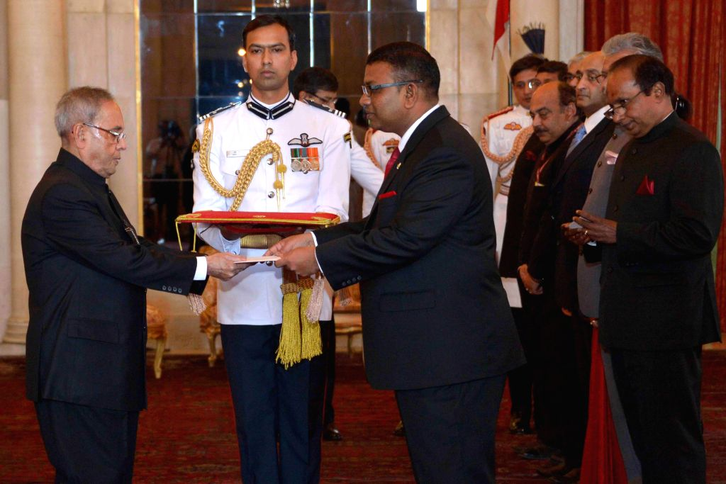 The High Commissioner designate of the Republic of Maldives in India,  H.E. Ahmed Mohamed presents his credentials to President Pranab Mukherjee during a programme at Rashtrapati Bhawan in New Delhi, ... - Pranab Mukherjee