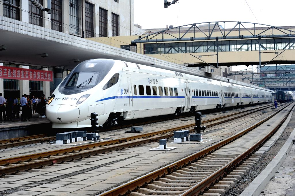 The high-speed train D7989 prepares to depart for Qiqihar at the Harbin Railway Station in Harbin, capital of northeast China's Heilongjiang Province, Aug. 17, 2015. ...
