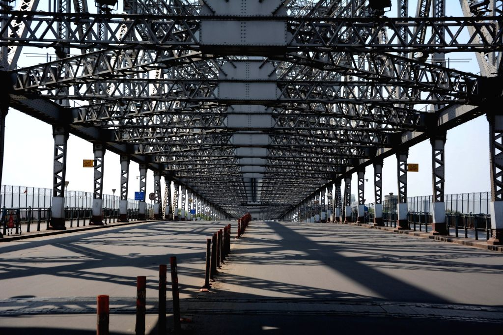 The Howrah bridge bears a deserted look on Day 2 of the 21-day nationwide lockdown imposed by the Narendra Modi government over the coronavirus pandemic; in Kolkata on March 26, 2020. - Narendra Modi