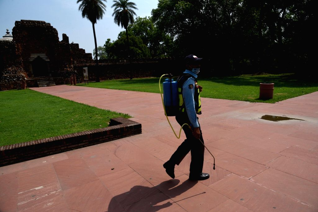 The Humayun's Tomb being sanitised, in New Delhi on July 5, 2020. The Central government on Thursday issued a slew of directions for reopening of monuments and museums, protected by the ...