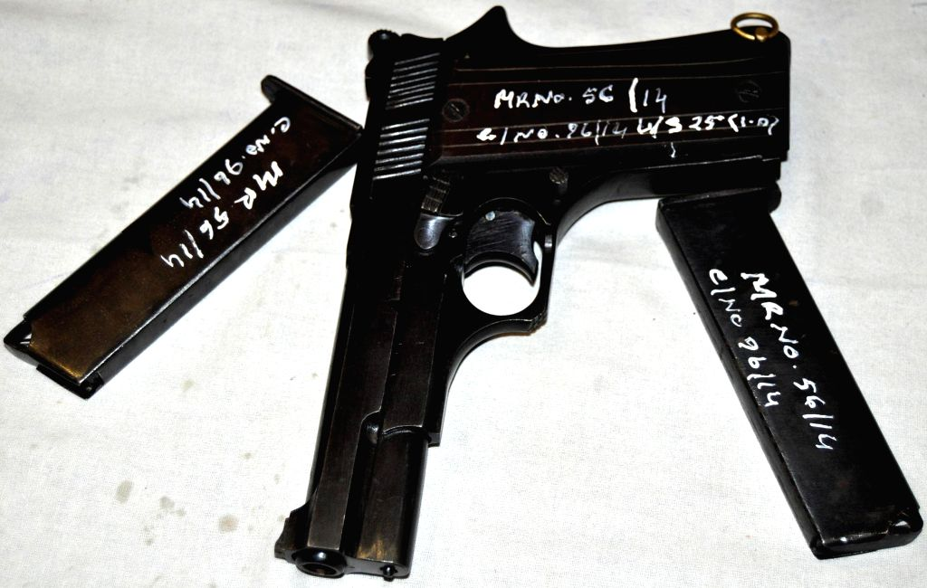 The illegal gun and empty magazines recovered from Kislay Kumar Dubey, a CRPF jawan who was apprehended by the Government Railway Police from Guwahati Railway station on the night of 7th September ... - Kislay Kumar Dubey
