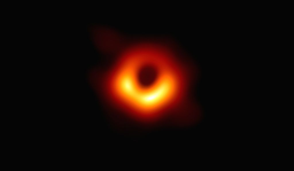 """The image -- taken by a network of eight telescopes across the world -- shows luminous gas swirling around a super-massive black hole 55 million light-years away at the centre of """"Messier 87. (Photo: ESO)"""