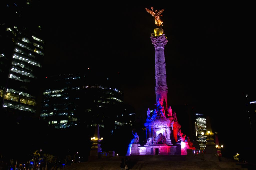 The Independence Angel Monument is illuminated with the French national flag colors, in Mexico City, capital of Mexico, early Nov. 14, 2015. At least 127 people ...