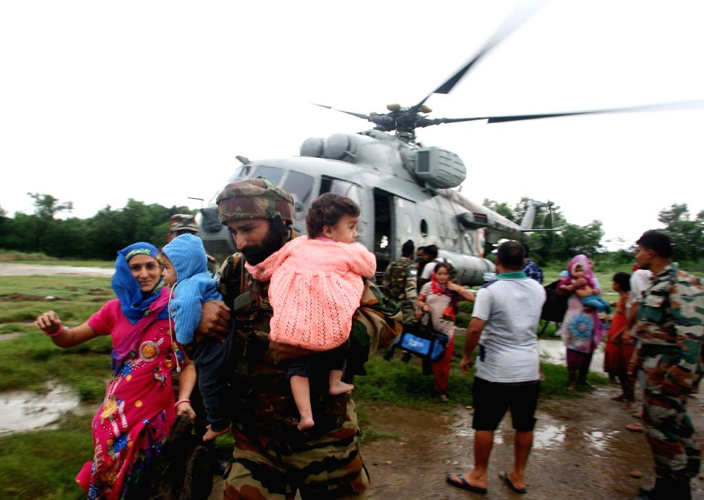 The Indian Air Force Helicopters carrying out rescue, relief and evacuation of people marooned during the flood fury, in Jammu and Kashmir.