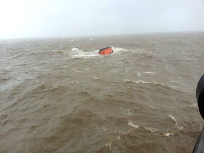 The Indian Navy personnel rescue the sailors of MV Coastal Pride merchant vessel which sank off Mumbai coast due to bad weather in Mumbai on June 24, 2015.