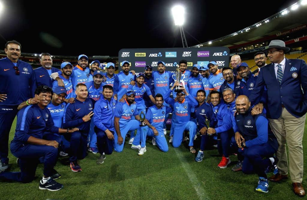 The Indian team poses with the trophy after a 35-run victory against New Zealand in the fifth and final One Day International (ODI) match, thereby clinching the limited overs series 4-1 ...