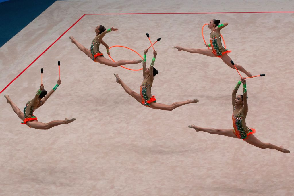 The Israeli team perform during the 6 clubs and 2 hoops in the group all-around competition at the Hungarian Rythmic Gymnastics World Cup in Budapest, Hungary on ...