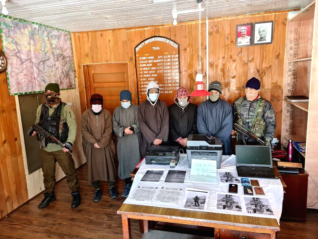 The Jammu and Kashmir police have arrested five people for pasting threat posters in Seer and Batagund villages of Tral area in Pulwama district of South Kashmir, officials said on Saturday.