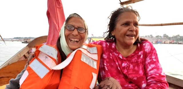 The joy of a life jacket protection... An elderly lady wearing a life jacket on a boat in Prayagraj.