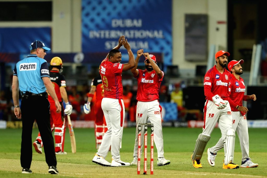 The Kings XI Punjab celebrates the wicket of Virat Kohli captain of Royal Challengers Bangalore during match 6 of season 13, Dream 11 Indian Premier League (IPL) between Kings XI Punjab and Royal ... - Virat Kohli