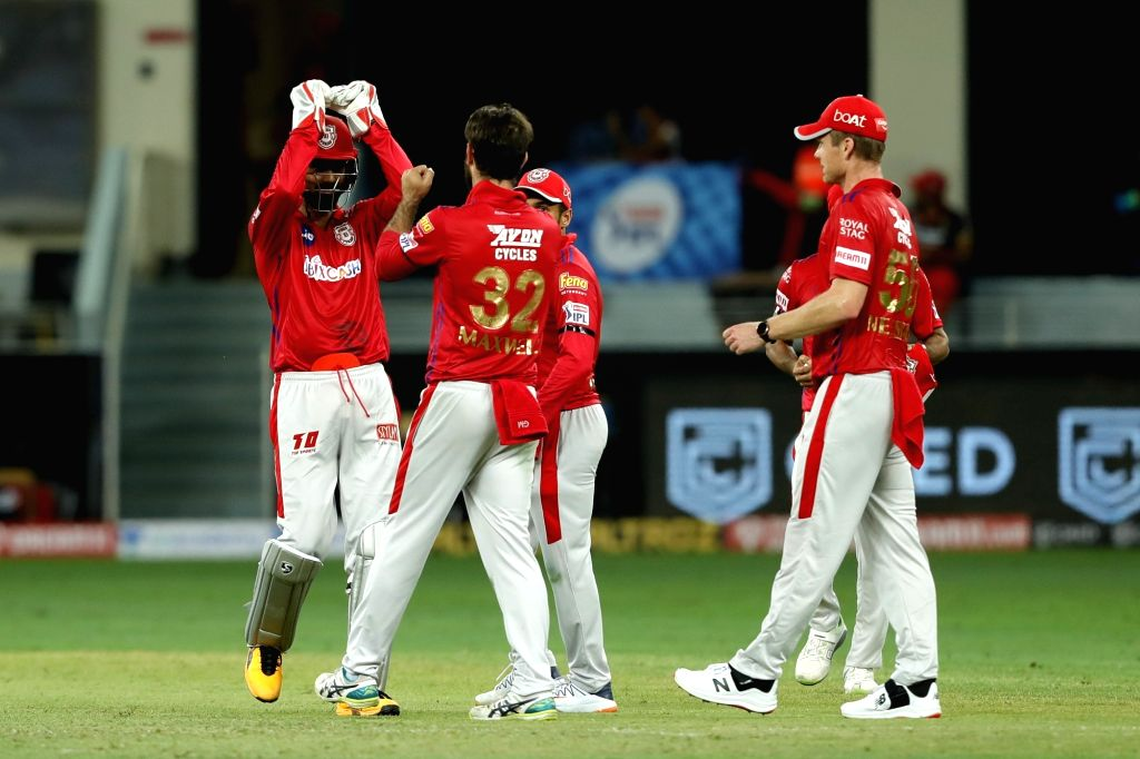 The Kings XI Punjab players celebrate a wicket of Royal Challengers Bangalore during match 6 of season 13, Dream 11 Indian Premier League(IPL) between Kings XI Punjab and Royal Challengers Bangalore ...
