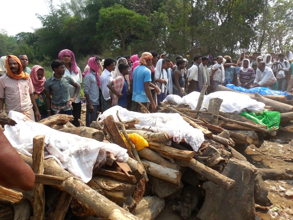 The last rites of people killed in Deogarh bus accident underway on April 18, 2016. At least 30 people were killed and eight injured when a bus carrying over 40 artistes of an opera ...