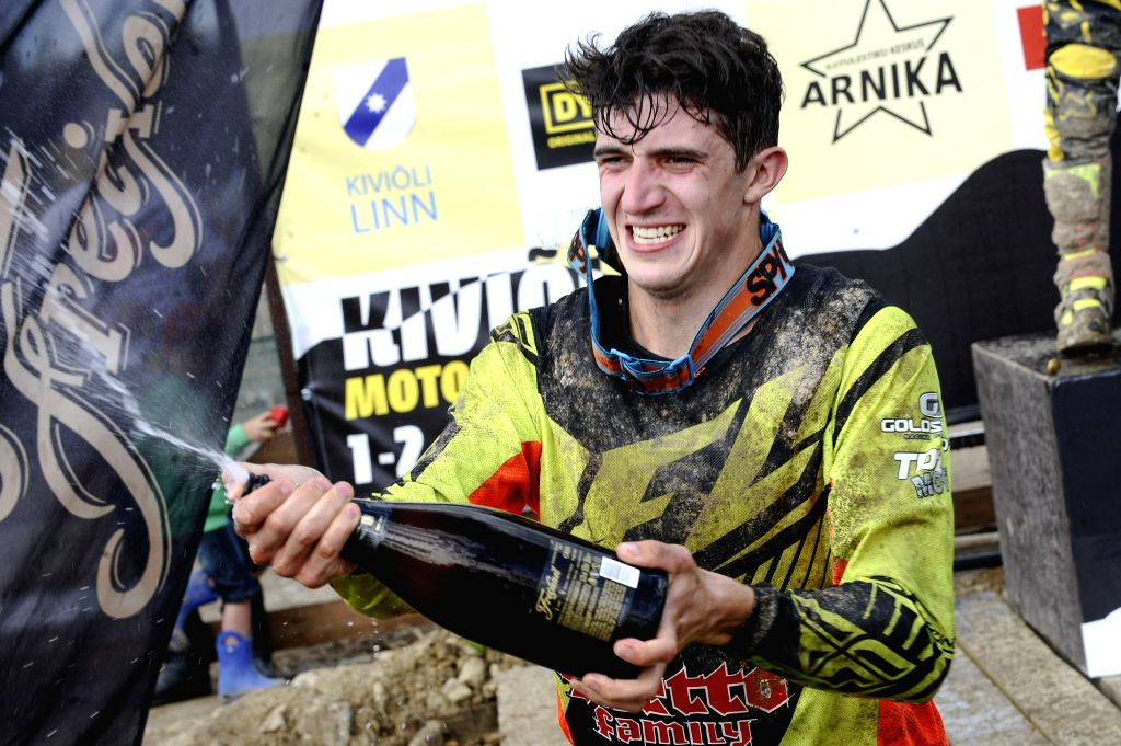 The leader of ITP Quadrocross European Championship and the winner of 5th round in Kivioli Latvian racer Edgars Mengelis celebrates during the flower ceremony at the ...
