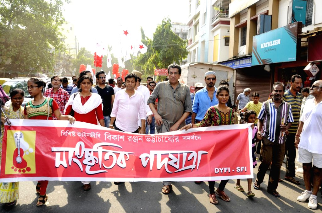 The Left Front supporters participate in a rally supporting CPI-M's Lok Sabha candidate from Jadavpur, Bikash Ranjan Bhattacharya for the forthcoming Lok Sabha polls, in Kolkata, on May 12, ...
