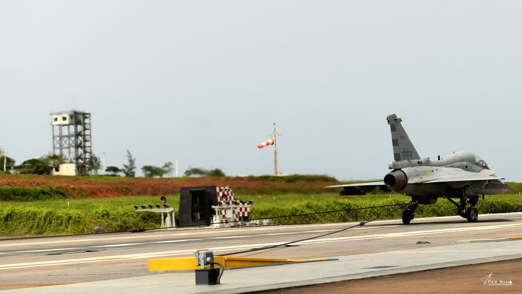 The Light Combat Aircraft's (LCA) naval variant lands on the deck of warship INS Hansa in Goa.