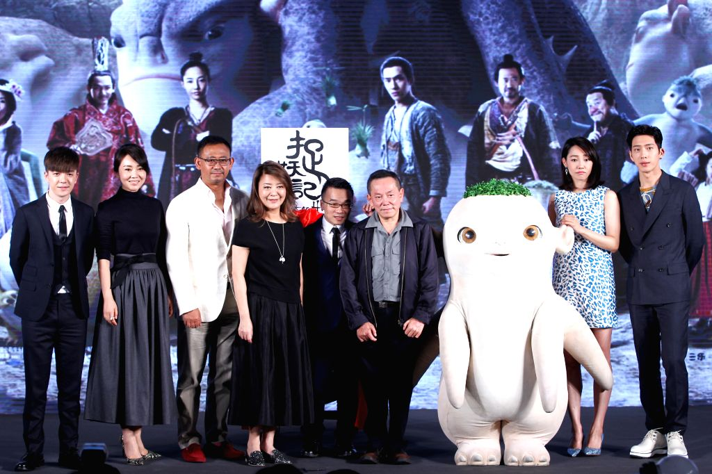 "The main cast and production team members of movie ""Monster Hunt"" pose for a group picture at the press conference of its premiere in Beijing, capital of ..."