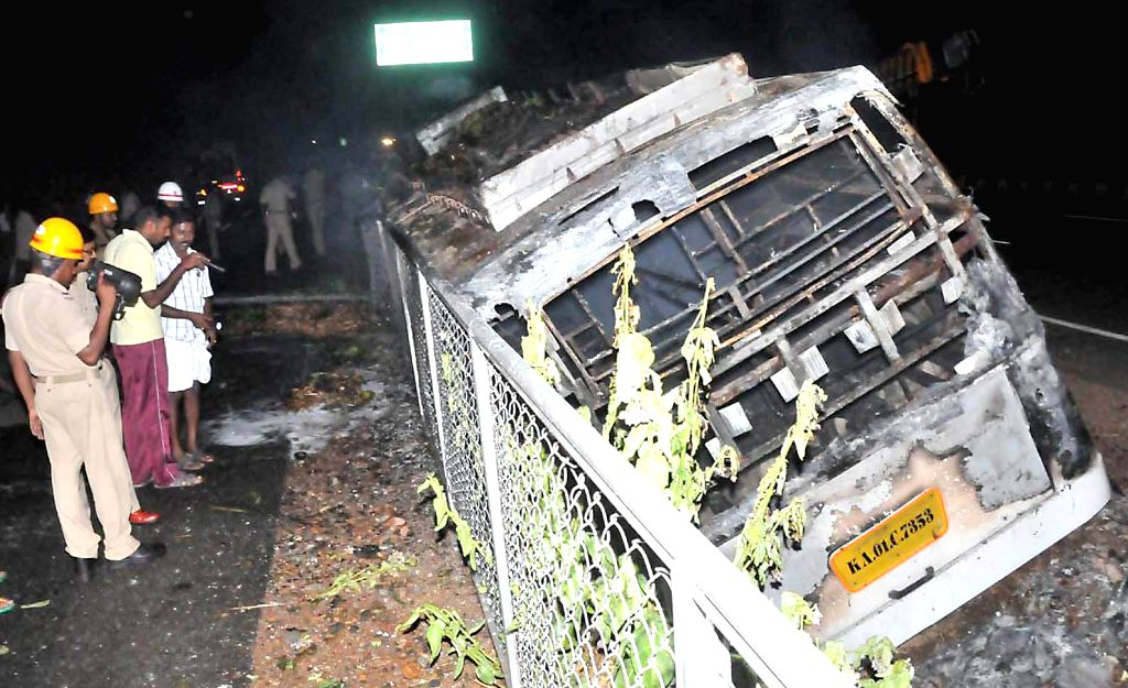 The mangled body of a bus which caught fire near Davanagere  in Karnataka on April 16, 2014. Reportedly atleast six persons were killed and several others injured in the accident.