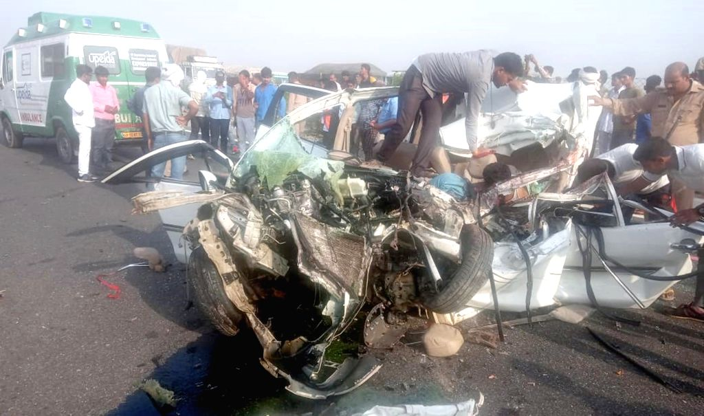 The mangled remains of a car after it collided with a truck on Lucknow-Agra expressway, on April 11, 2019. Reportedly, 8 people were killed in the accident.