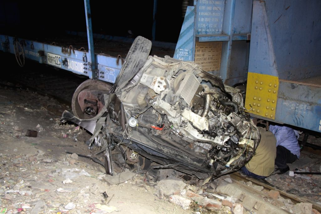 The mangled remains of a four-wheeler that was hit by a goods train in New Delhi on Oct 27, 2020. Two persons were injured in the mishap who were admitted in a hospital near Jal Vihar ...