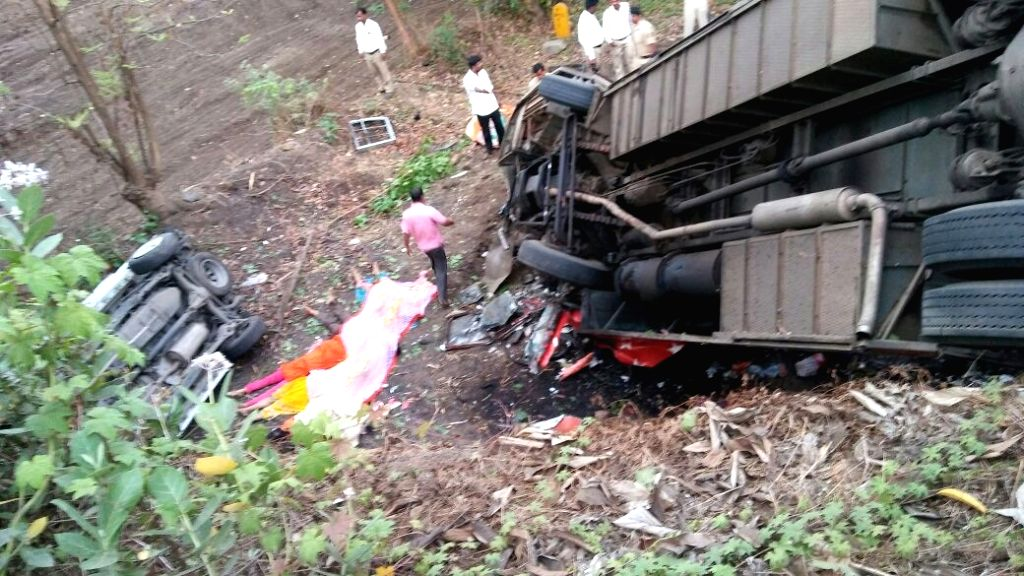 The mangled remains of the bus and  the cars that met with an accident on the Mumbai-Pune Expressway (E-Way) near Panvel of Maharashtra on June 5, 2016. At least 17 persons were killed and 21 ...
