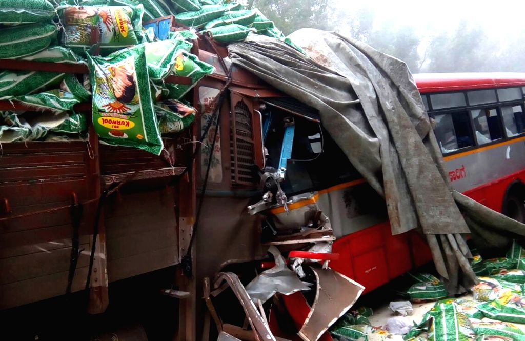 The mangled remains of the bus and truck that collided head-on killing at least five and  injuring 10 others on Mysuru-Hunsur Highway at Madhugirikoppalu in Karnataka on Oct 26, ...