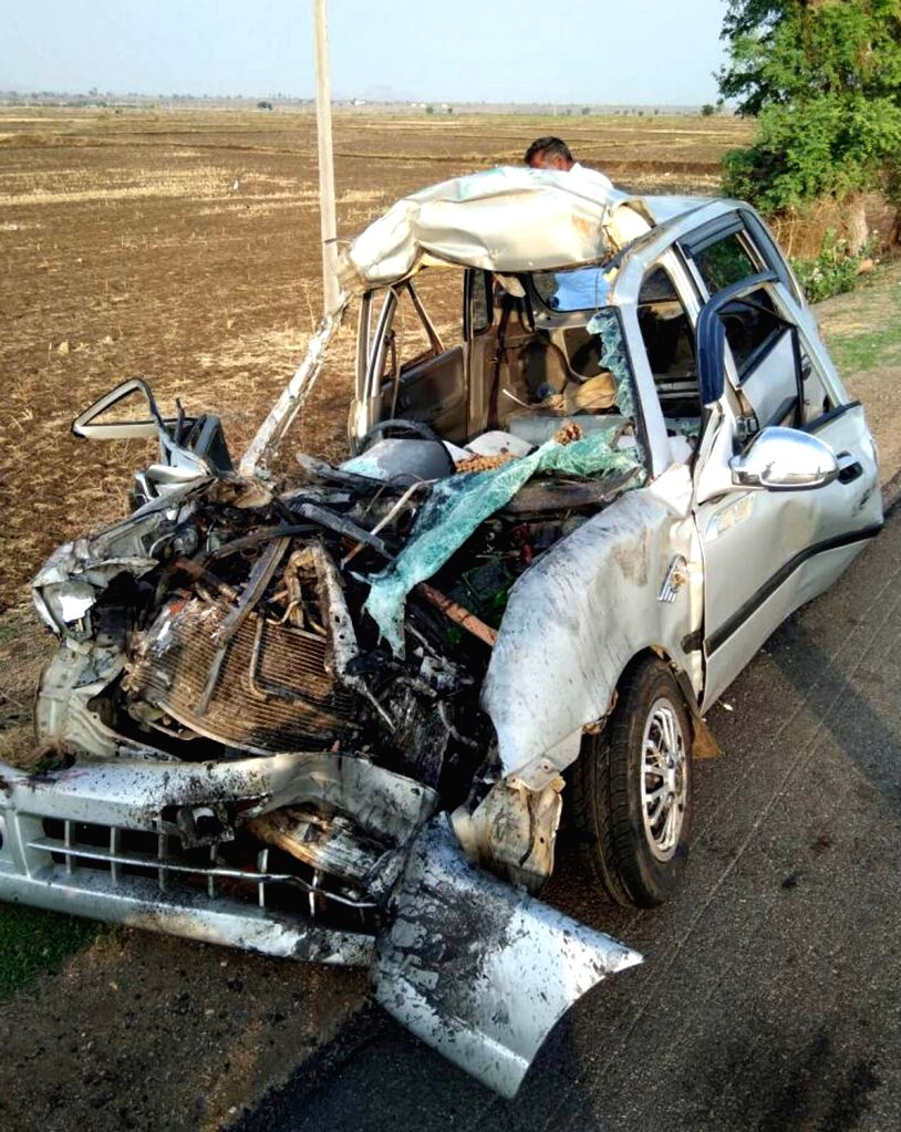 The mangled remains of the car that rammed into a truck at Dadhesoguru near Sindhanur, in Raichur district of Karnataka on May 20, 2017. Reportedly five persons of a family including three ...