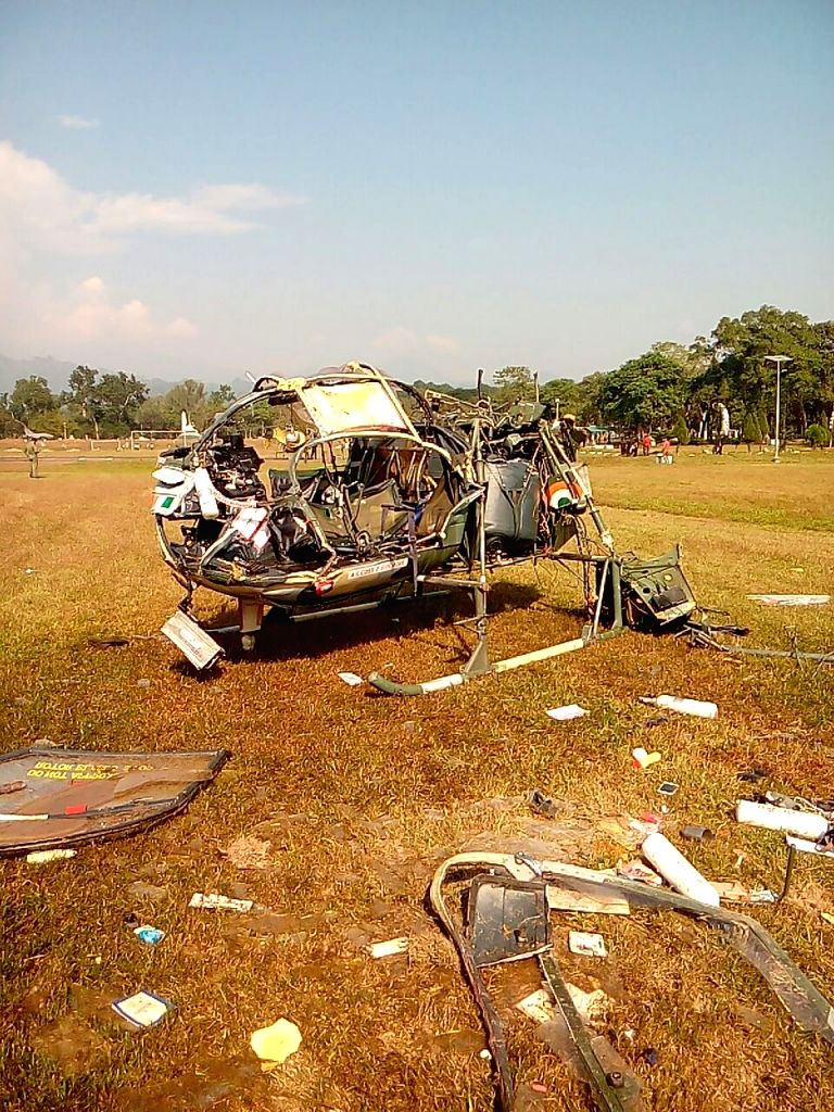 The mangled remains of the Cheetah helicopter crashed inside the Sukna military base in West Bengal's Darjeeling district on Nov 30, 2016. Three army officers died and another was critically ...