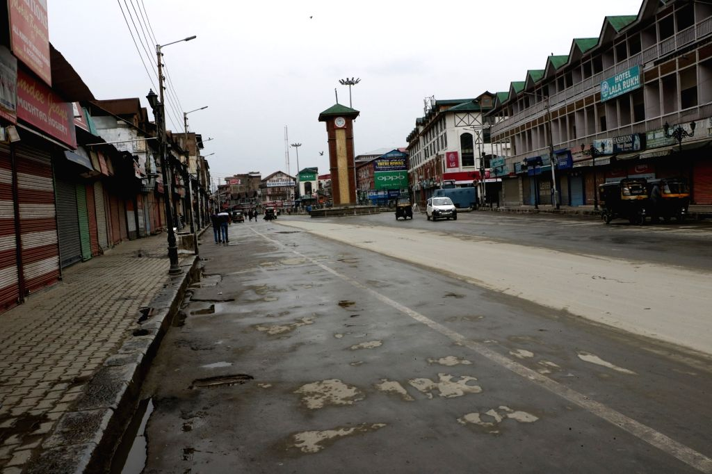 The market and streets wear a deserted look as shops remain shut after separatists extended their protest shutdown against the killings of four civilians in Shopian district following which ...