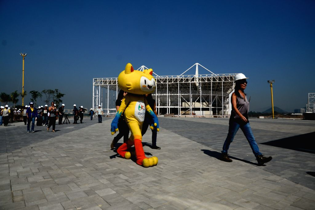 The mascot of the Olympic Games in Rio 2016, Vinicius, makes a tour at the Olympic Park in Barra Tijuca, in Rio de Janeiro, Brazil, on Aug. 5, 2015. According ...
