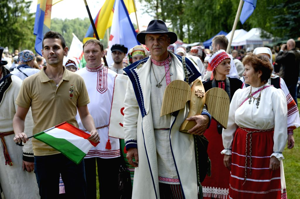 The mayor of Obinitsa (C) holding a symbol of Finno-Ugric culture capital city attends the Seto Kingdom celebration in Obinitsa, Estonia, Aug. 2, 2015. This year's ...
