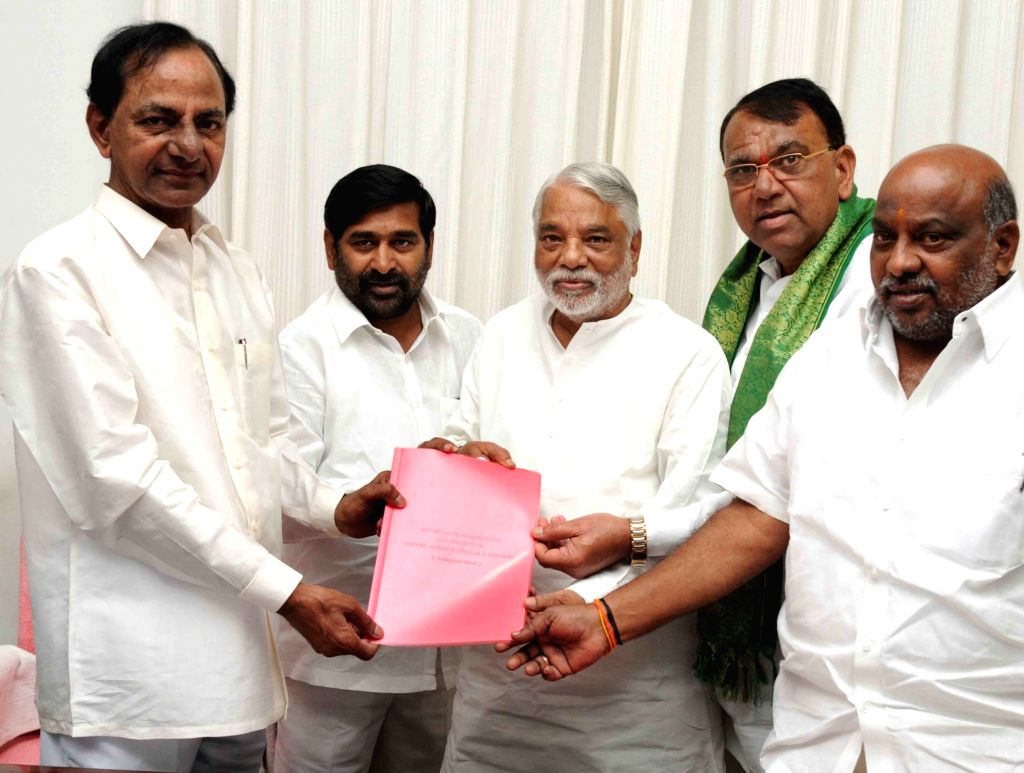 The members of a high power committee on district reorganization headed by TRS MP K Keshava Rao calls on Telangana Chief Minister K Chandrasekhar Rao to submit their report to him in ... - K Chandrasekhar Rao and K Keshava Rao