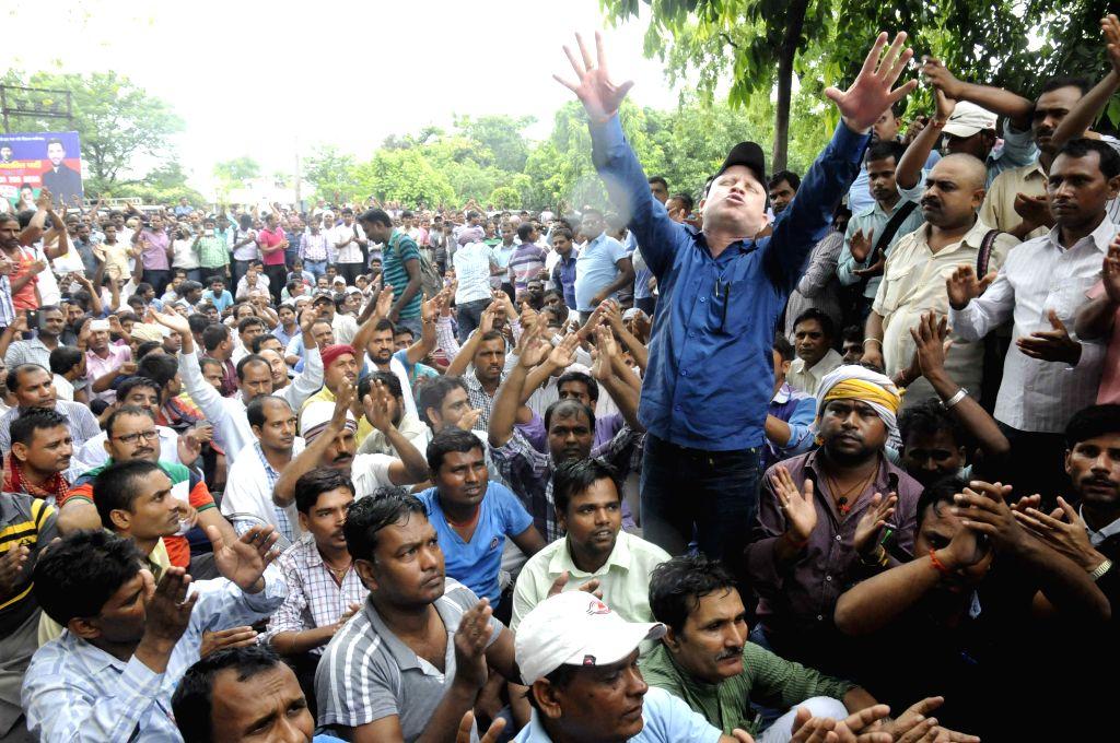 The members of Bihar Panchayat Rojgar Sevak Sangh stage a demonstration in Patna on June 25, 2015.