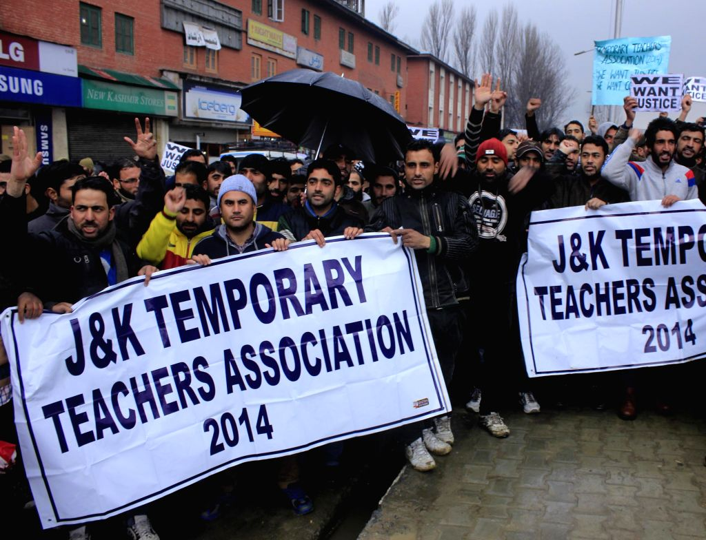 The members of Jammu and Kashmir Temporary Teacher's Association stage a demonstration in Srinagar, on Feb 18, 2015.