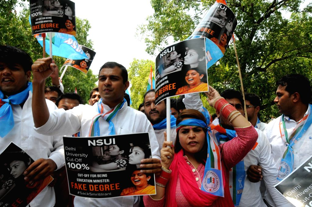 The members of NSUI stage a demonstration against Union Human Resource Development Minister Smriti Irani in protest against giving false information about her educational qualification in ...
