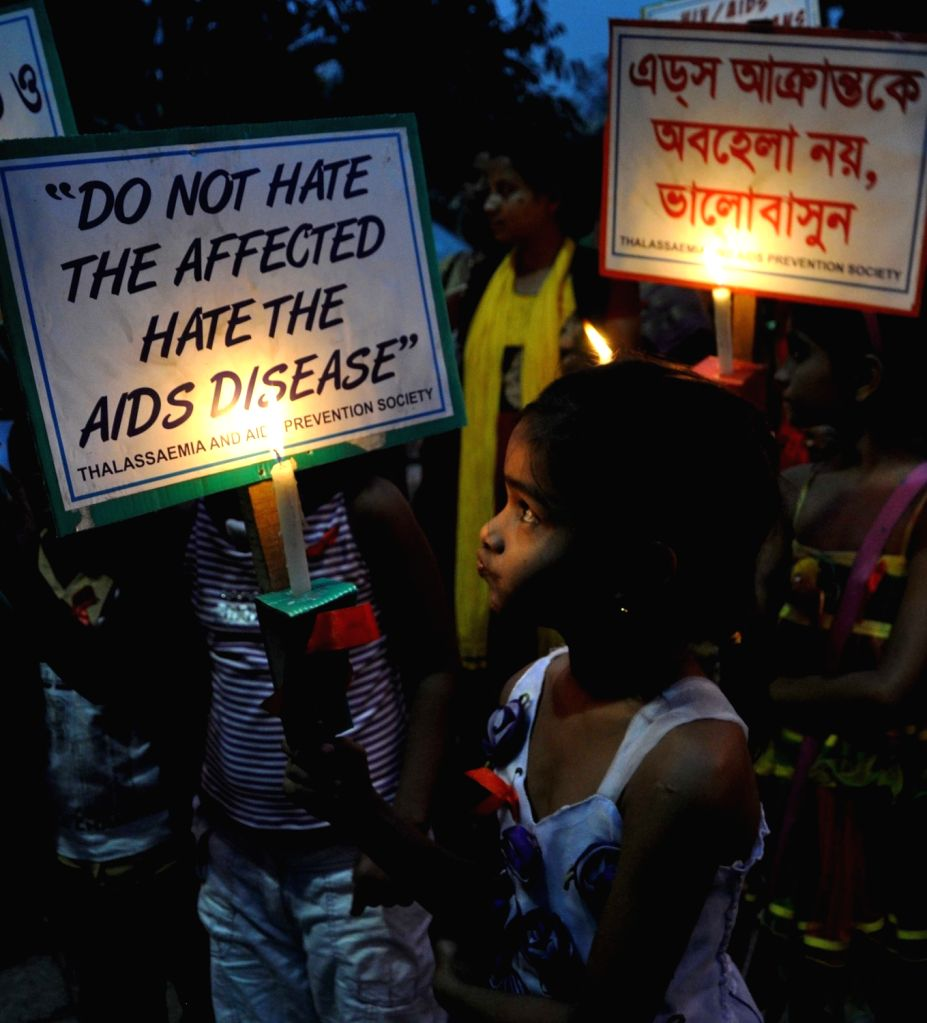 The members of Thalassaemia and AIDS Prevention Society hold a candle light march and released hot air balloons during an awareness campaign ahead of World AIDS Day in Kolkata on Nov 30, ...