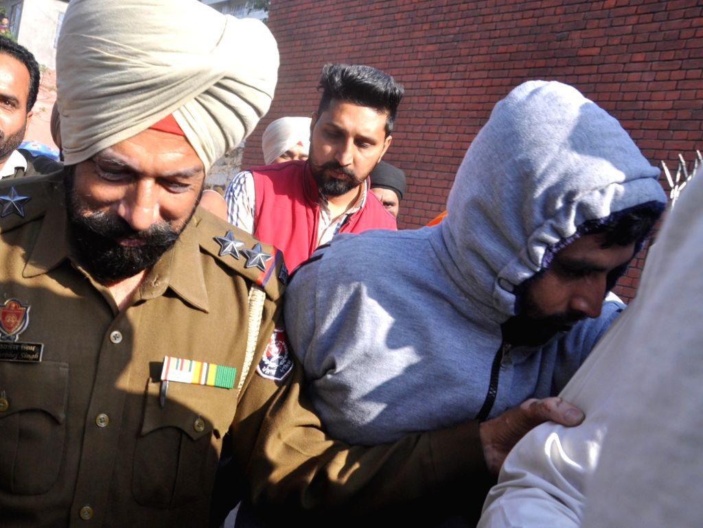 The Military Engineering Services employee posted in the crucial Jalandhar cantonment, identified as Ram Kumar, being taken away after he was arrested by Punjab Police's intelligence wing ... - Kumar