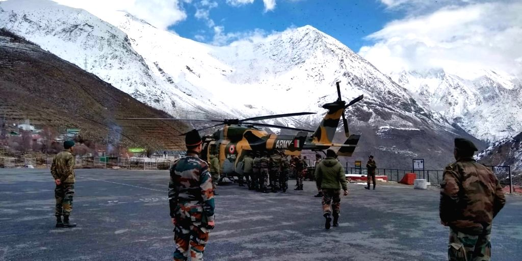 The mortal remains of a soldier who died in Himachal Pradesh avalanche being airlifted to Ghumarpur village in Bilaspur district from Kinnaur on Feb 22, 2019.