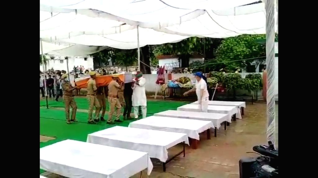 The mortal remains of the eight police personnel who lost their lives in an encounter with criminals, being brought at Police Lines in Kanpur on July 3, 2020. Uttar Pradesh Chief Minister ...