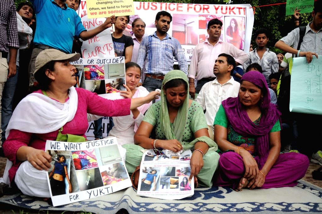 The mother and other relatives of 18-year-old Delhi girl who allegedly committed suicide demonstrate to demand proper probe in the case in New Delhi on July 13, 2014. The girl was doing bachelor in ..