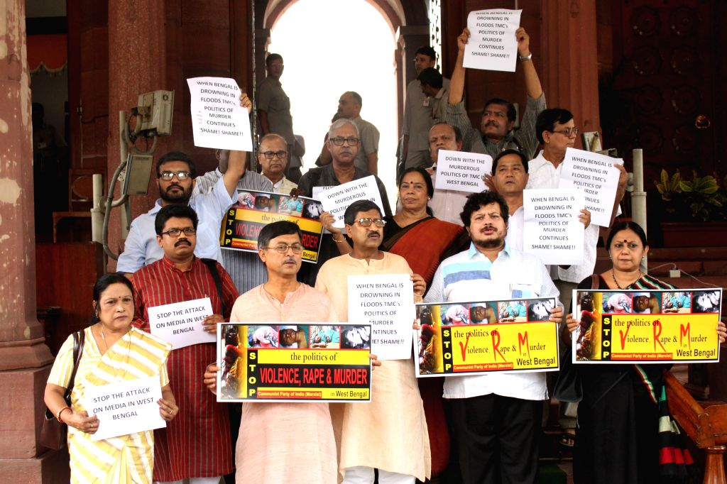 The MPs of Left parties stage a demonstration at the Parliament in New Delhi, on Aug 11, 2015.