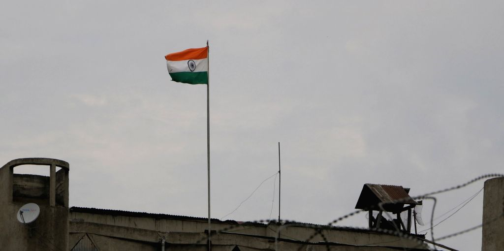 The National Flag flies on top of the Civil Secretariat building in Srinagar, on Aug 26, 2019. The flag of Jammu and Kashmir which used to fly along with the tricolour was removed from the ...