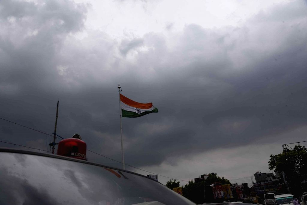 The national flag flutters in th air on a windy and overcast day in Patna on May 7, 2020.