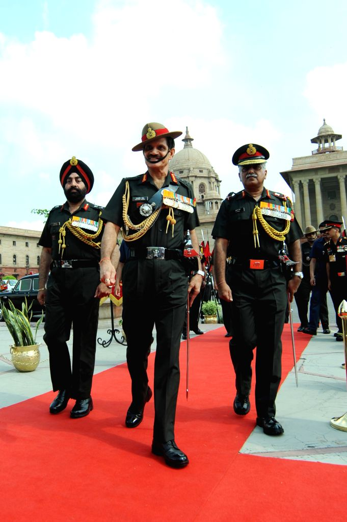 The new Indian Army Chief General Dalbir Singh Suhag inspecting a guard of honour before taking charge at the South Block in New Delhi on Aug. 1, 2014.