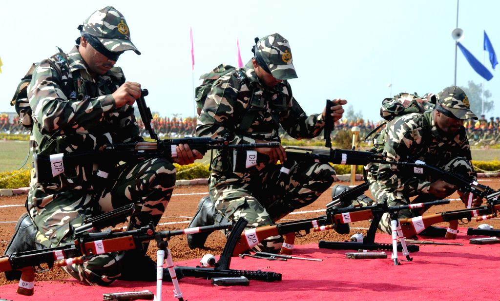 The new recruits of Central Armed Police Forces` Sashastra Seema Bal (SSB) contingent during their Passing Out Parade in Bhopal on Jan.3, 2014. Around 300 cadets from all over the country participated in the parade. (Photo: IANS)