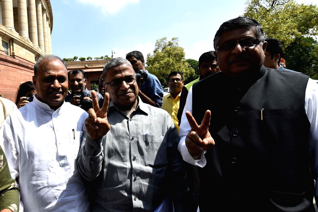 The newly elected  Rajya Sabha Deputy Chairperson Harivansh Narayan Singh and Union Minister and BJP MP Ravi Shankar Prasad show victory sign at Parliament, in New Delhi on Aug 9, 2018. ... - Harivansh Narayan Singh