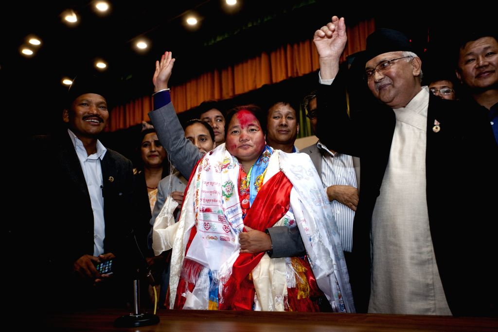 The newly-elected Speaker of Nepal's Parliament Onsari Gharti Magar (C, front) waves after the election at parliament house, Kathmandu, Nepal, Oct. 16, 2015. ...