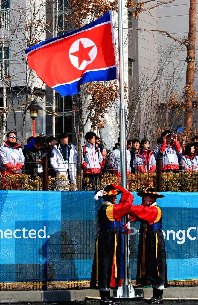 The North Korean flag is hoisted during an entrance ceremony of the North Korean team for the PyeongChang Olympics at the Olympic Village in Gangneung, a sub-host city of the Olympics, on ...