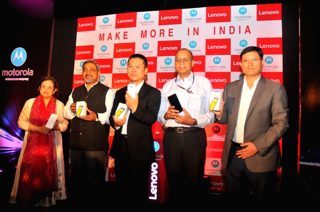 The officials of Lenovo and Motorola during a joint press conference in New Delhi, on Aug 18, 2015.
