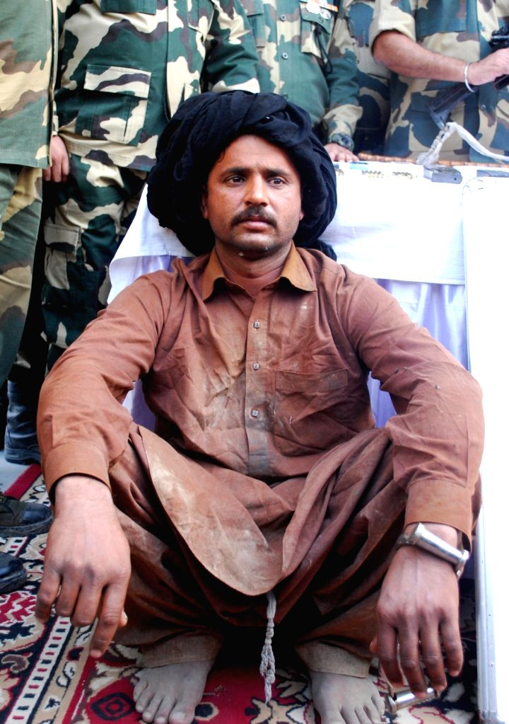 The Pakistani national who was arrested by the BSF near the Border Out Post in Ramkot near Amritsar on Nov 5, 2018. A US-made automatic gun, 24 cartridges and three mobile phones with ...