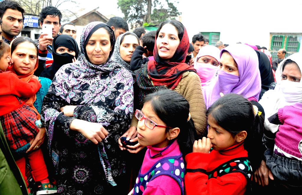 The Pakistani wives of  former militants who returned home under the state government's rehabilitation policy stage a demonstration in Srinagar alleging that nothing has been done for them by the ...